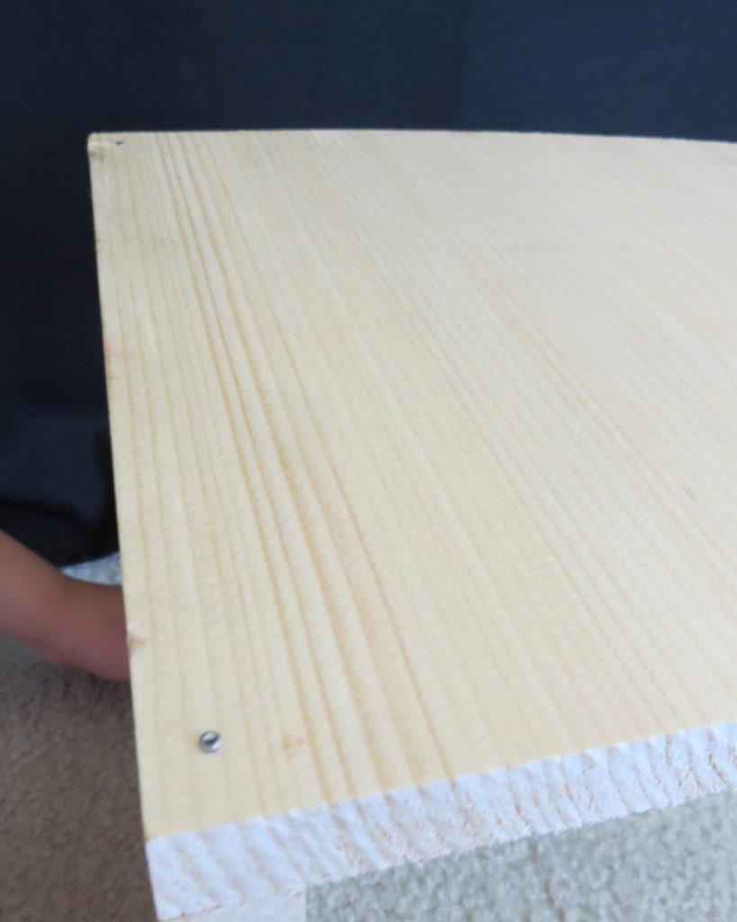 nail hammered into wood