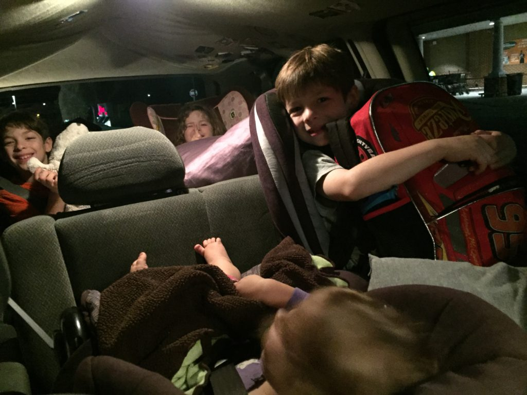 Children traveling in a van